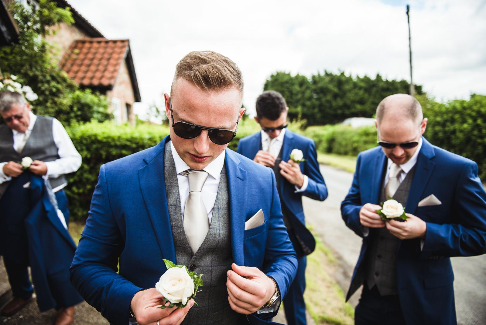 men getting ready on their wedding morning