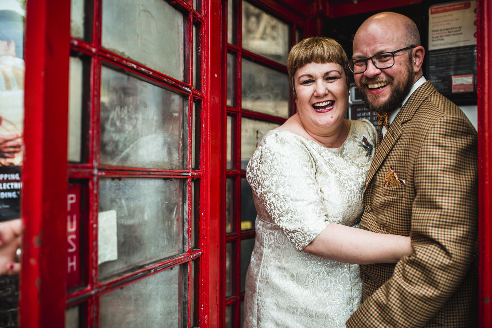 Red telephone box wedding portraits with bride and groom. Outside York Minster.