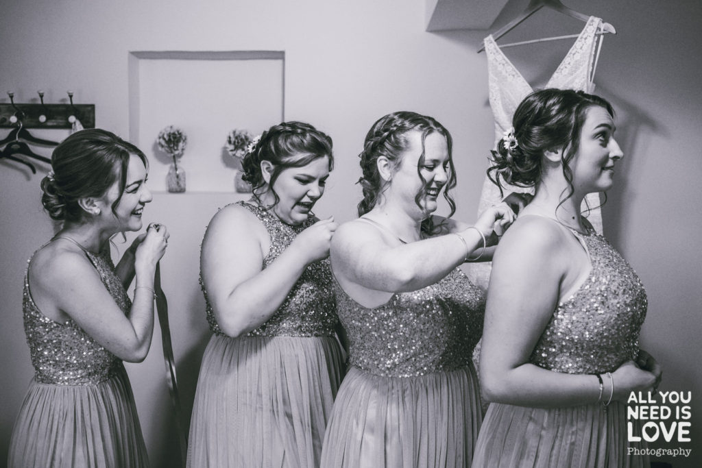 Bride and bridesmaids getting ready in the cottage at the Normans, in York.