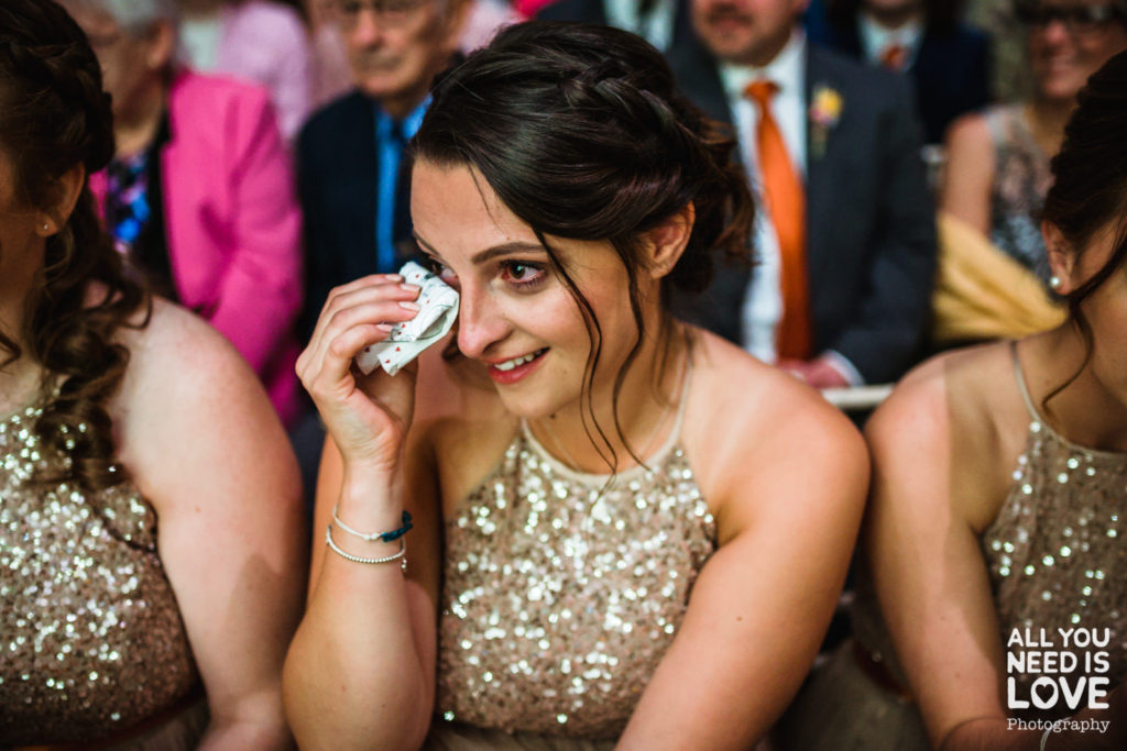 Emotional photograph of bridesmaid during the ceremony